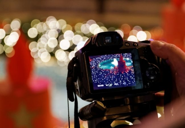 Camera being held up so you can see the Christmas lights on the screen