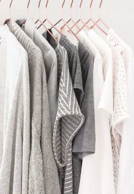 Organized Clothes Closet - Gray and White Clothes on hangers