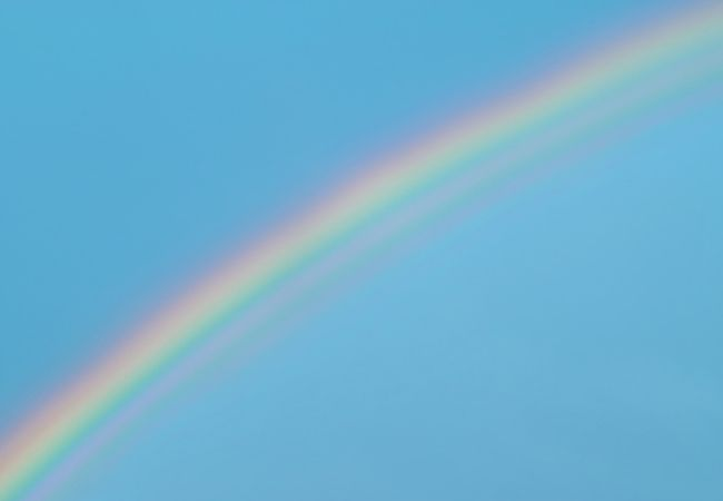 31 Spring Hygge Ideas - Rainbow in a blue sky