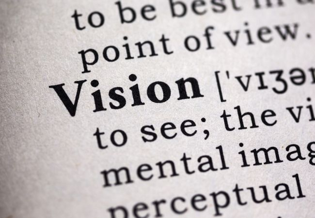 Close-up of the word Vision and it's definition in a dictionary