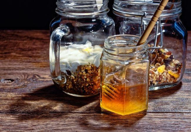 Breakfast grains in mason jars and jar of honey