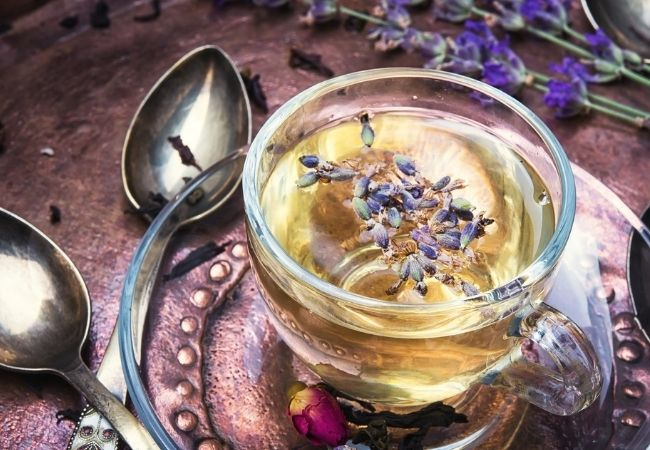 Cup of lavender tea with two spoons