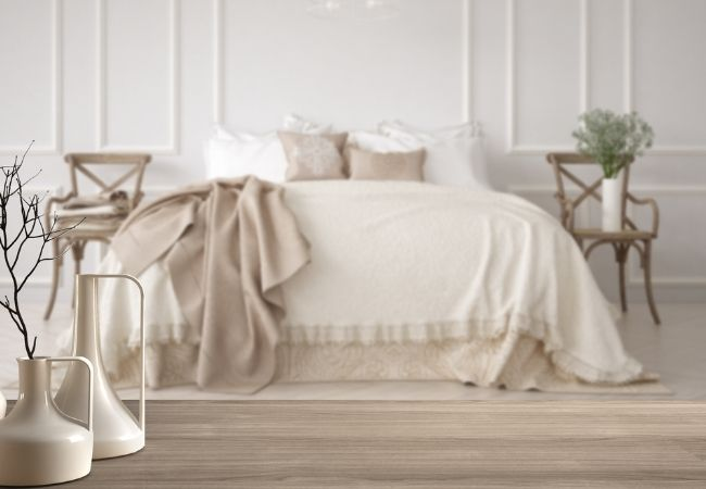 Minimalist Bedroom - Bed with white and tan coverings