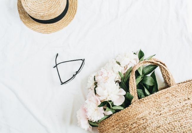Minimalist Ideas - straw hat, glasses, straw basket with flowers