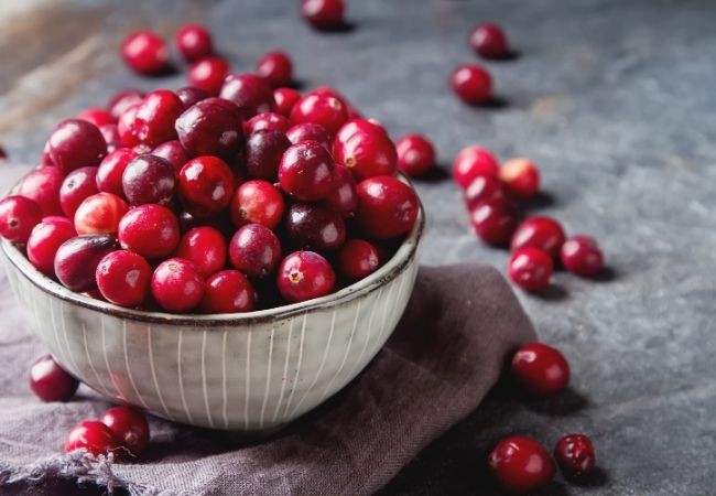 Bowl of fresh cranberries on a towel