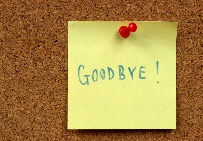 Goodbye written on a stick note pinned to a bulletin board - save money by saying goodbye to cable
